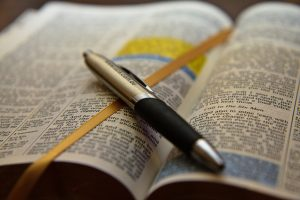 Open Bible with Pen by Ryk Neethling